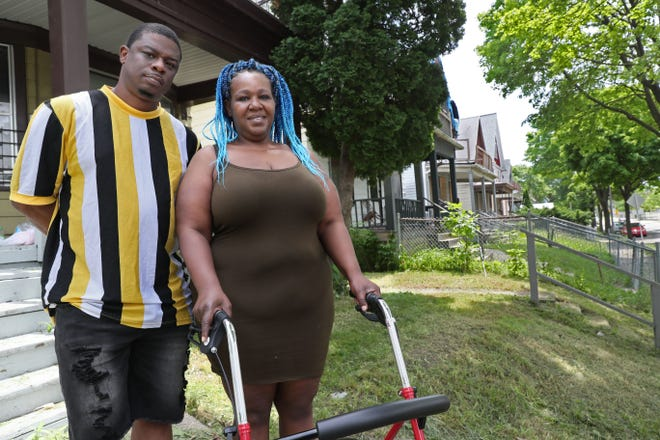 Tari Davis, left, and LaTeasha Russ of Milwaukee. Davis was shot by police Sept. 8, 2019 as they were pursuing another man. He believes the incident played a factor in his family being evicted from their home in April 2020.